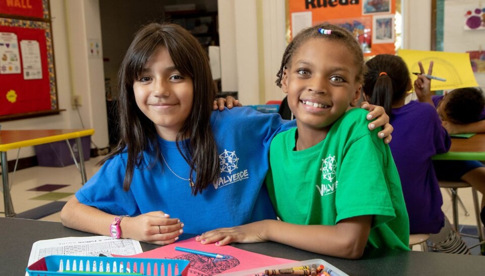 Two Valverde Elementary students smile for the camera