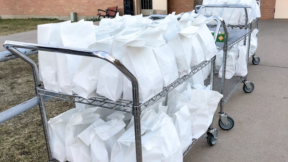 Grab-and-go meal bags on carts