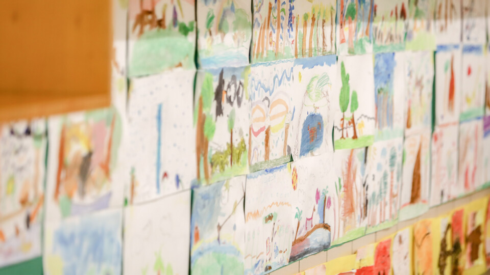 Classroom wall covered in student paintings