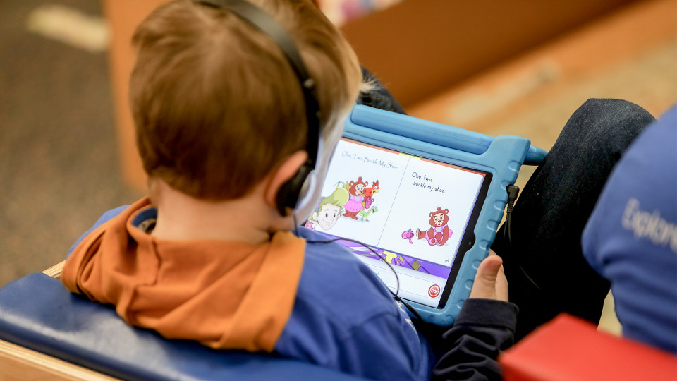 Student playing educational games on an iPad