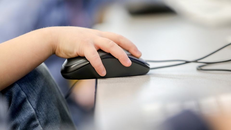 Student holding a computer mouse