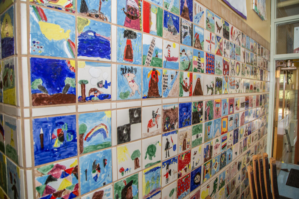 Wall of tiles painted by students