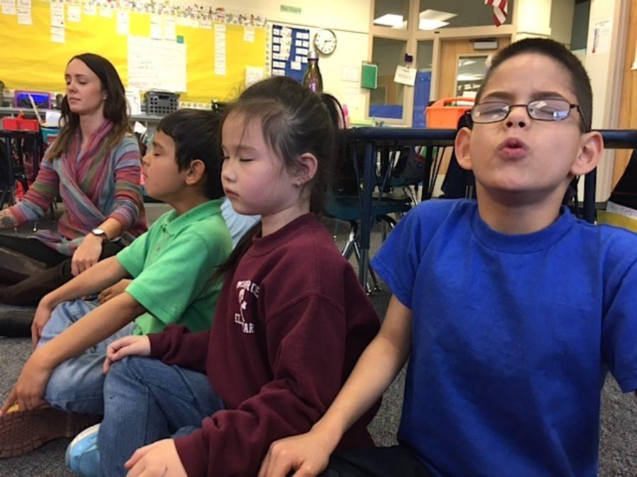 2016-12-15_585312004ba6e_First-graders-doing-mindfulness-900x0-c-default