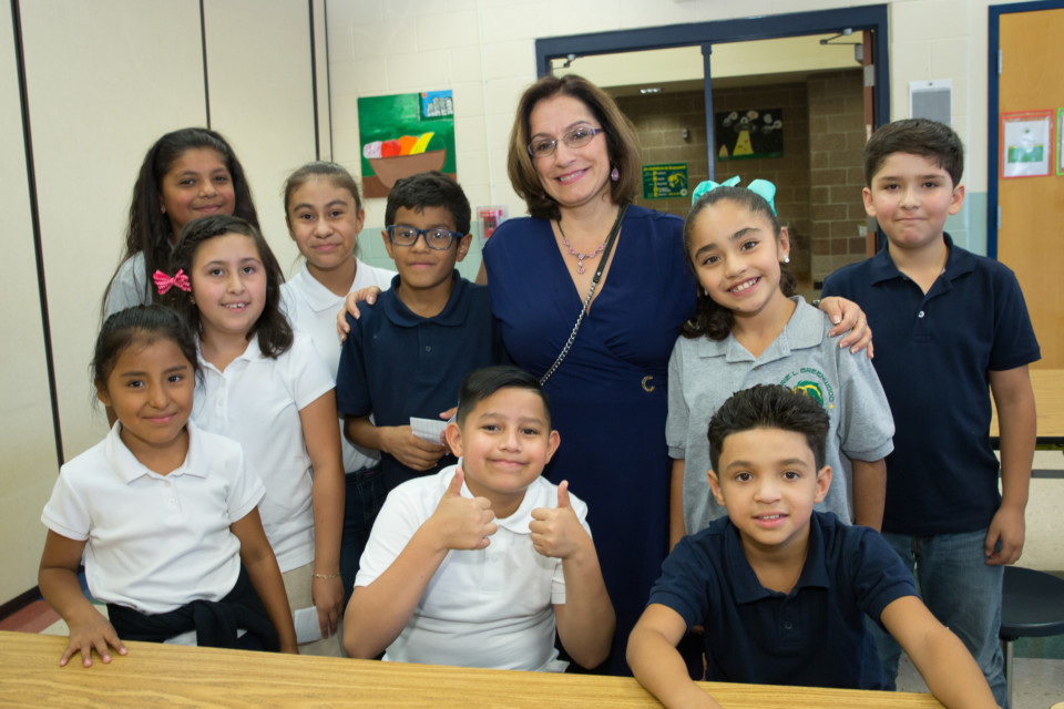 Susana Cordova poses with students at Marie L. Greenwood.