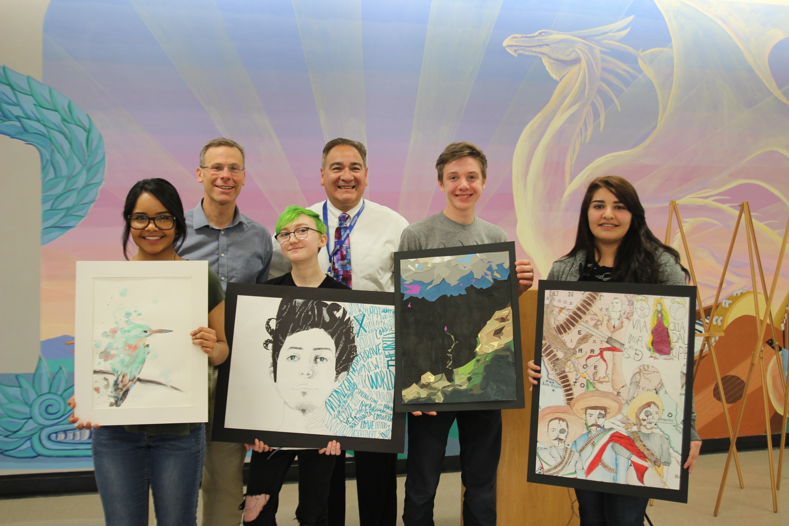 DPS Superintendent Tom Boasberg, back left, and Kunsmiller Creative Arts Academy Executive Principal Peter Castillo celebrated the school's 100% graduation rate in 2015-16 with KCAA student artists.