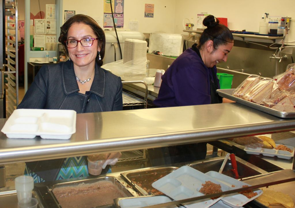 Deputy Superintendent Susana Cordova serves meals to children and families at Barnum Elementary School.