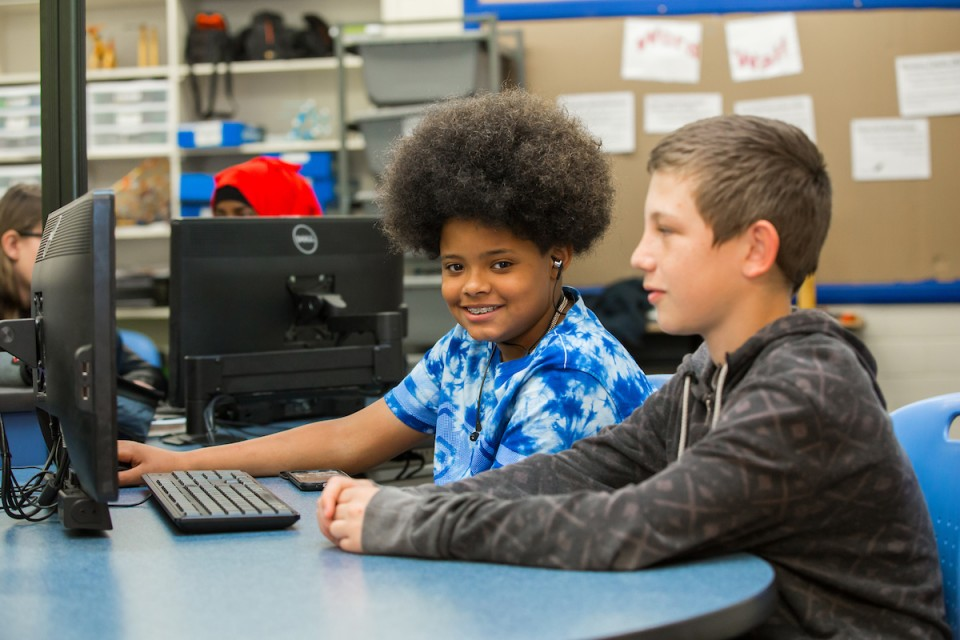 Two Denver Public Schools children at a computer