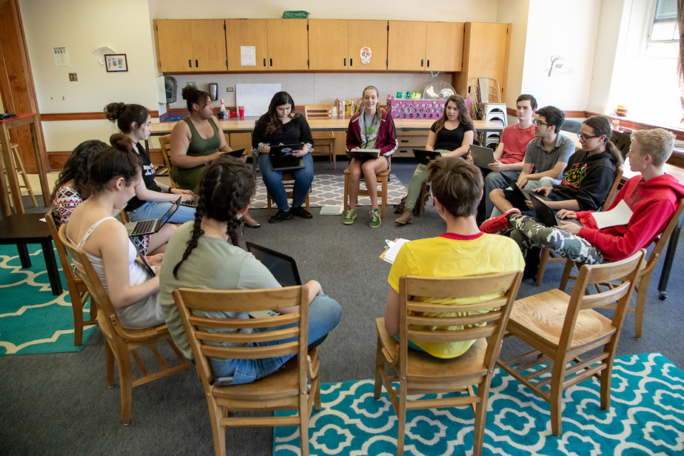 Students sit in a circle having a discussion