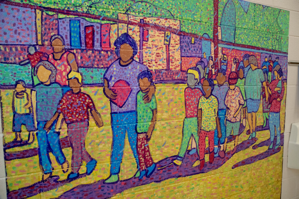 Colorful mural artwork at Eagleton Elementary showing families walking to school