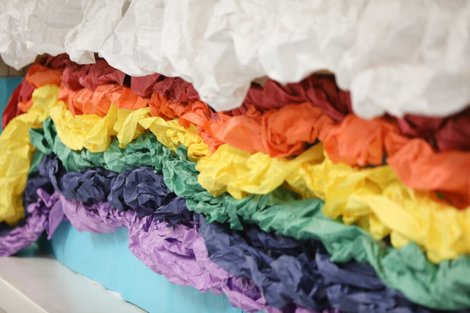 A tissue-paper rainbow display at a DPS school.