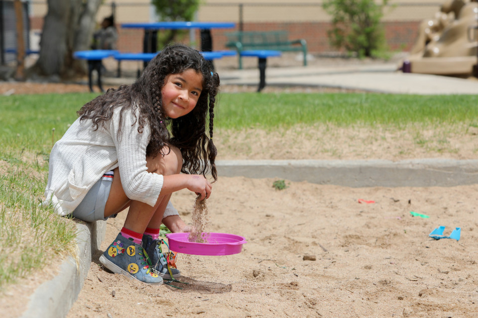 Student playing in the sandbox
