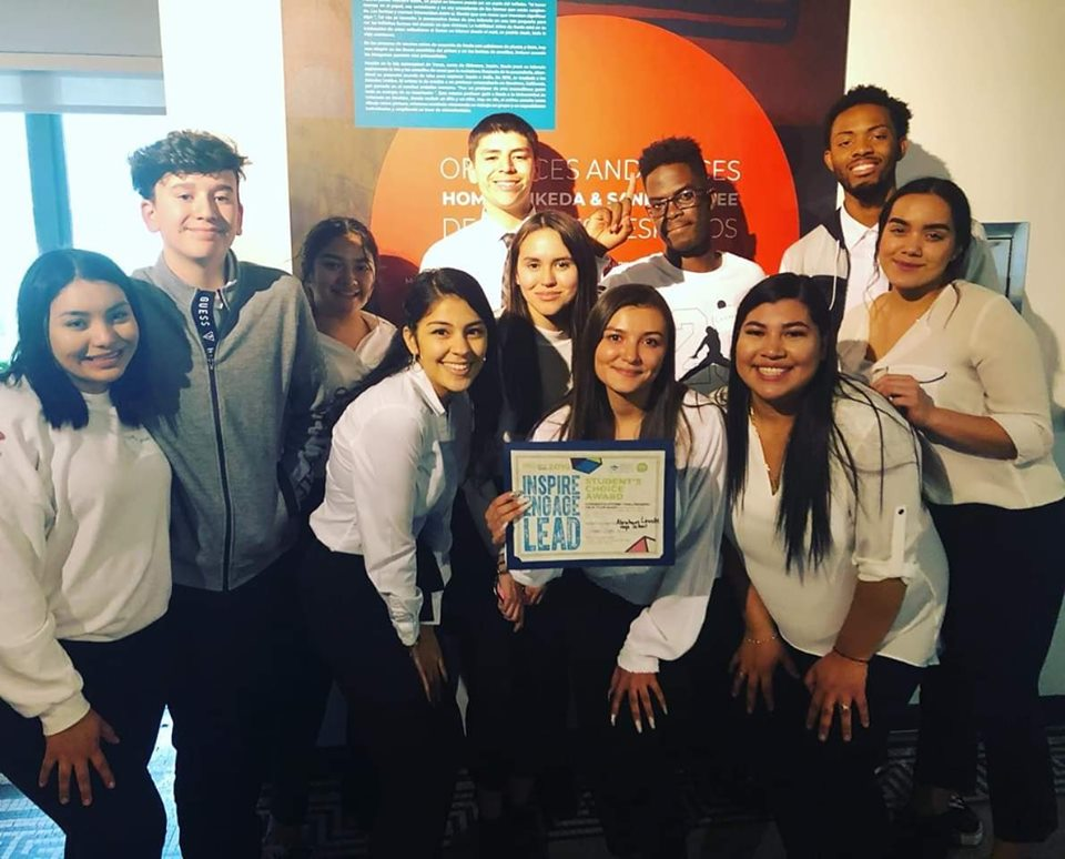 Group of Abraham Lincoln High School students holding a certificate and posing for the camera