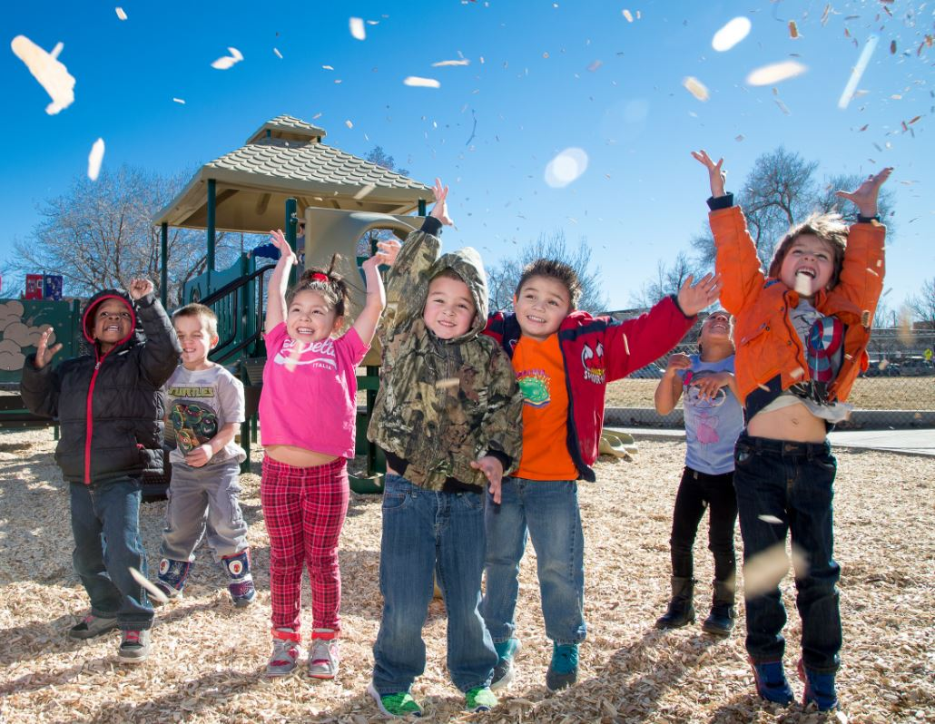 kids jumping outside