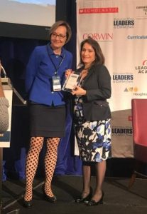 Deputy Superintendent Susana Cordova accepting her Leader to Learn From award.