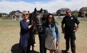 Board of Education members Barbara O'Brien and Rachele Espiritu meet the Denver Police Department's newest equestrian officer.