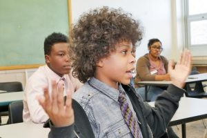 "A student participates in a discussion during ""Changing the Narrative."""