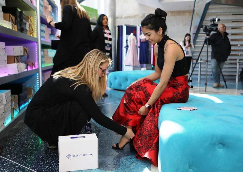 DPS student gets fitted for prom shoes at by a TLC stylist at the Say Yes to the Prom event.