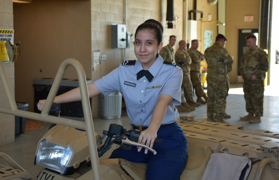 Catherine Hernandez gets a feel for the 10th Special Forces Group Polaris ATV, which has been modified for military use.