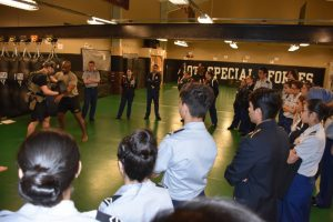 Two 10th Special Forces Group Combative Instructors give a demonstration of hand-to-hand combat to West High JROTC Cowboys.