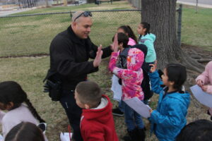Denver Police Department Officer High Fives Students at Force Elementary School