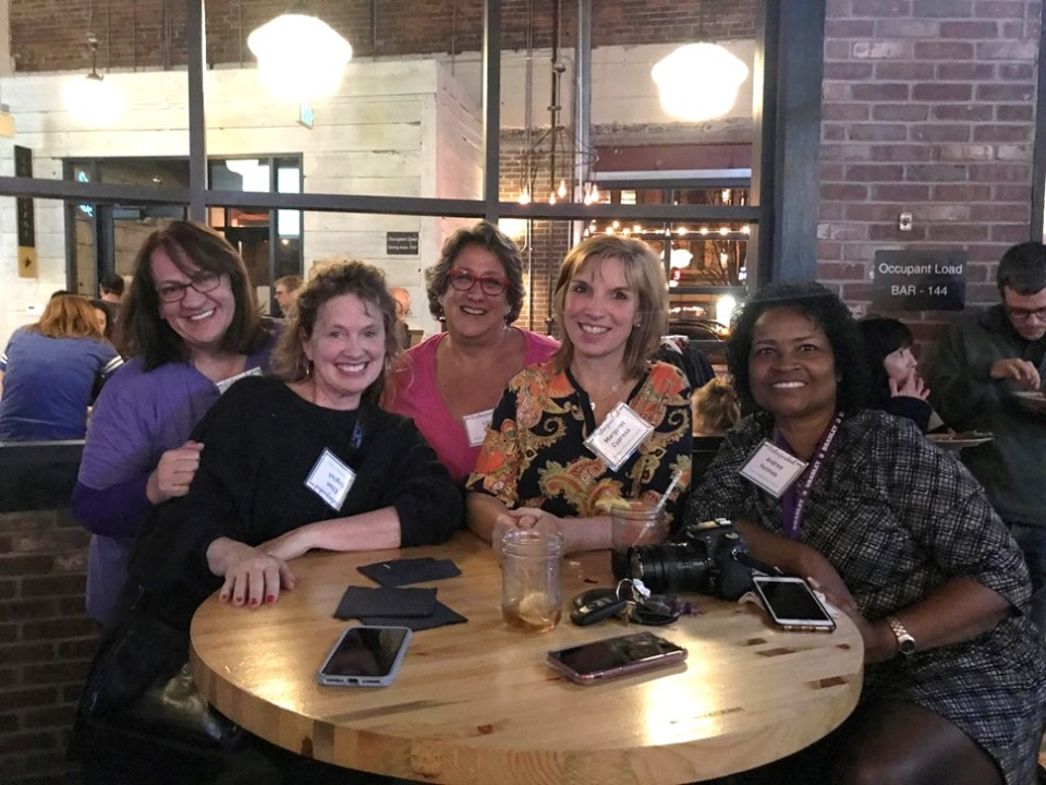 Teachers celebrate together during Excellence in Teaching