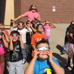 Mr. Comer's class observes the solar eclipse at Cheltenham on the first day of school.