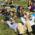 Supt. Tom Boasberg and U.S. Senator Michael Bennet observe the solar eclipse at Newlon Elementary on the first day of school.