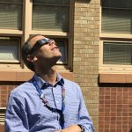 Supt. Tom Boasberg observes the solar eclipse on the first day of school.