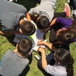Students gather to learn about the solar eclipse of the first day of school at Newlon Elementary.