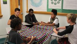 GWHS freshmen hand tied fleece blankets to donate to Children's Hospital.