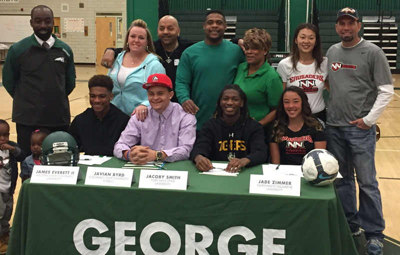 Student-athletes and their families celebrate National Signing Day at George Washington High School.