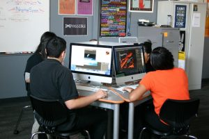 Students learn graphic design at West Campus.