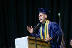 Student in graduation regalia.