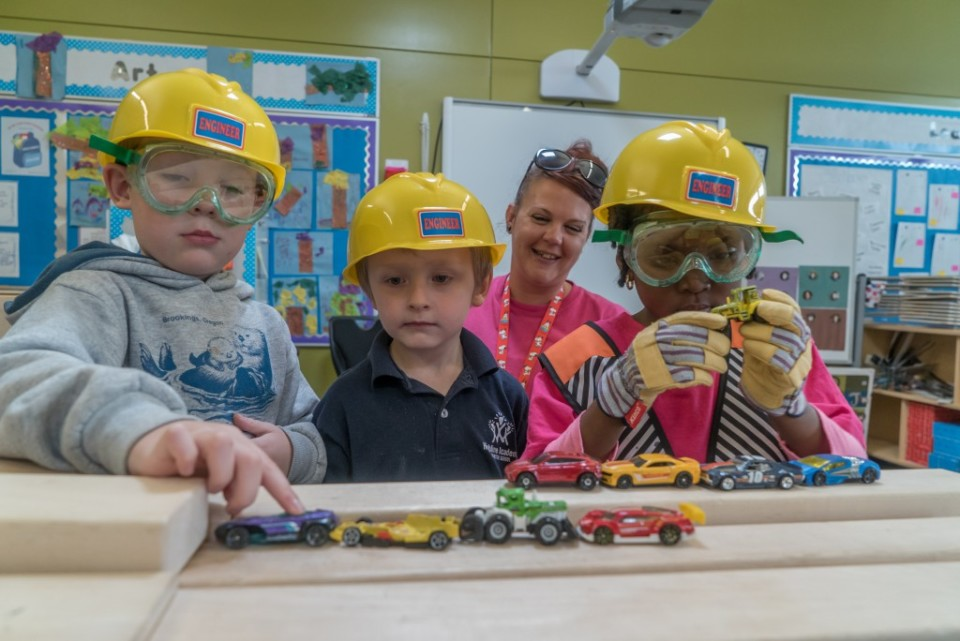 Kids with hard hats playing