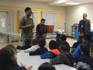 Denver Broncos' Brandon Marshall returns to Swansea Elementary to reward students with perfect attendance with a pizza party.