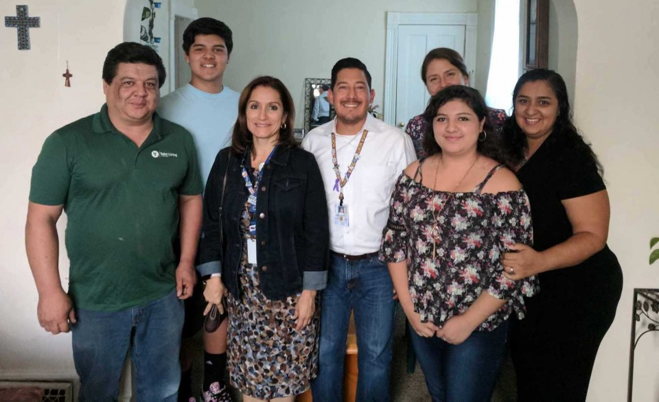 North High School students Clara and Diego Fierro-Rayas pose for a photo with their parents during a visit to their home by Deputy Superintendent Susana Cordova and North educators German Echevarria and Joanna Wood.