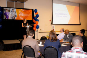 """Lauren Trent, executive director for DPS CareerConnect, addresses the crowd of education, government and industry partners during the """"Celebration of Partner Impact"""" breakfast Friday, May 17."""