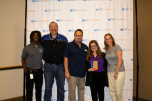 """DPS CareerConnect team members recognized United Airlines with a """"Partner of the Year"""" award."""
