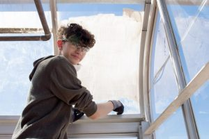 Students at JFK worked with engineers to renovate the school's greenhouse.