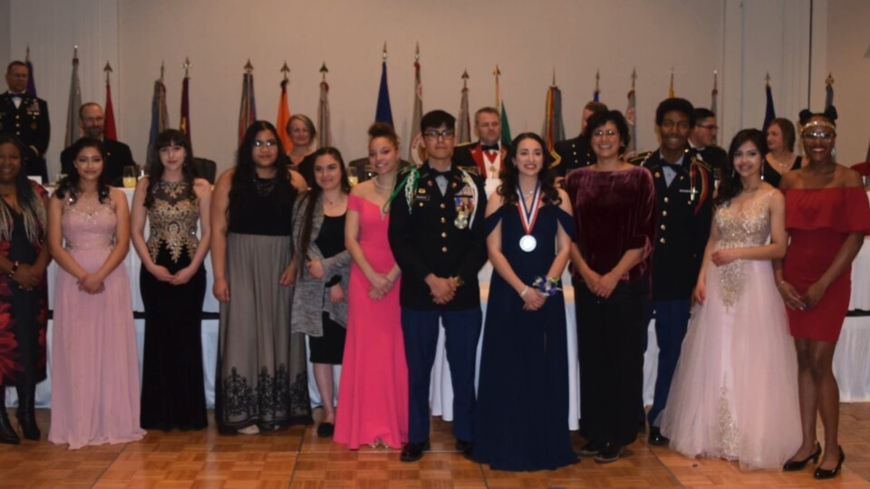 Cadets (students) dressed in formal attire from DPS JROTC pose for a photo at their annual Military Ball event