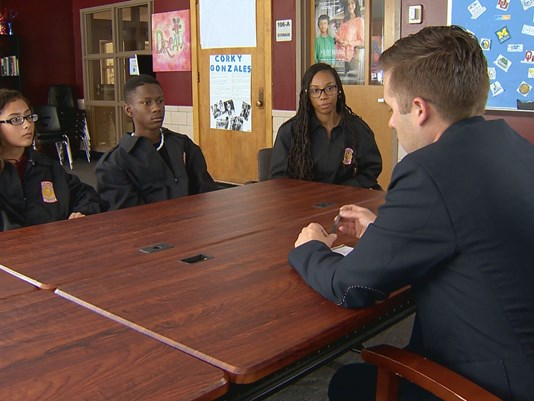 Manual High School students visit with a reporter from 9news