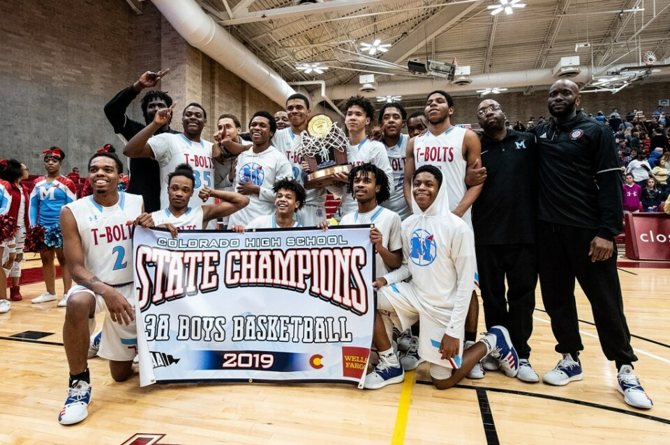 Manual students pose with state champions banner