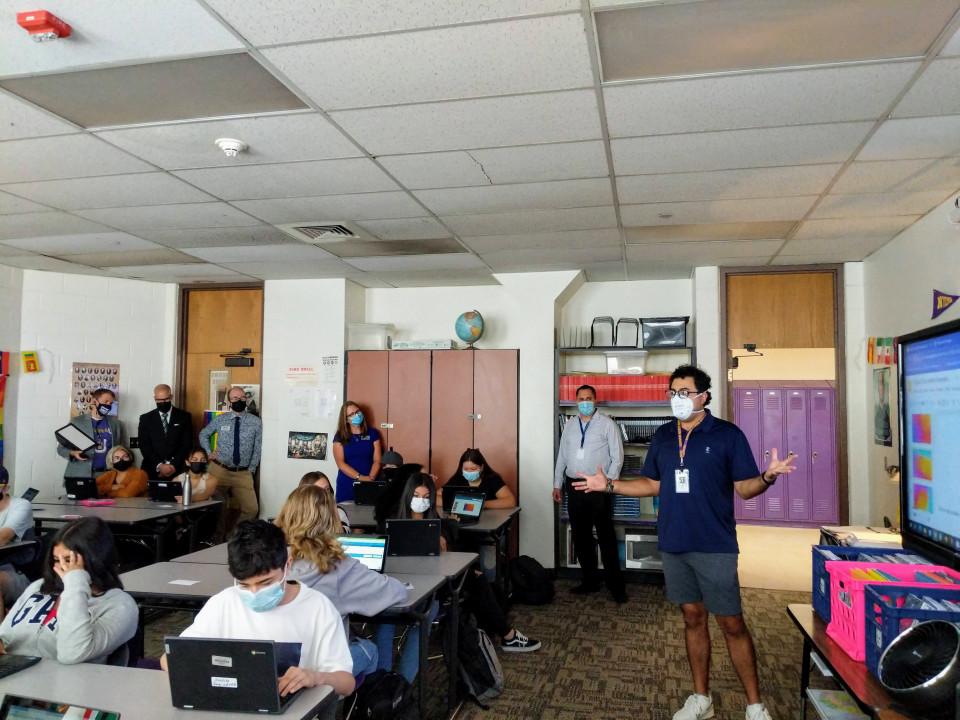 Dr. Alex Marrero sits in and observes a classroom