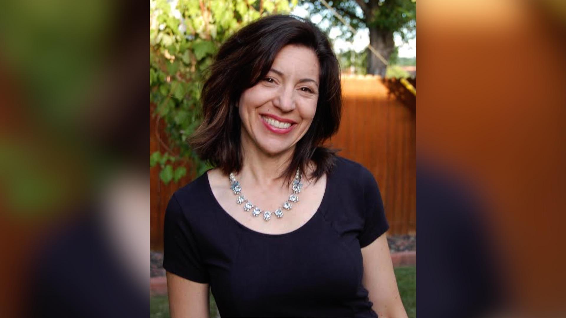 Priscilla Hopskins smiles, posing for a photo outdoors