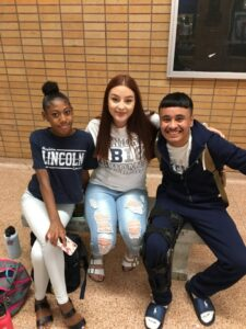 Three high school students from Abraham Lincoln HS pose for a photo