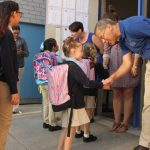 Supt. Tom Boasberg greets students on the first day of school