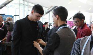 Male student wearing tuxedo.