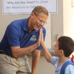 Supt. Tom Boasberg Greets students with a high-five