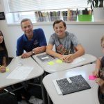 Supt. Tom Boasberg sits with Northfield IB students