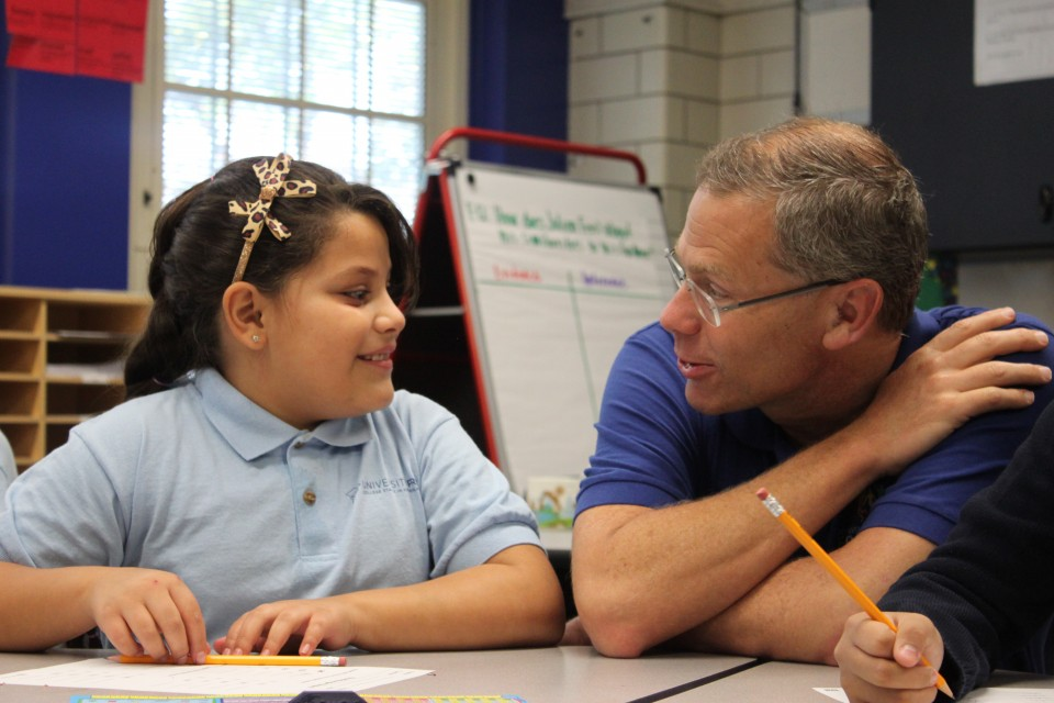 UPrep Steele student explains her classwork to Supt. Tom